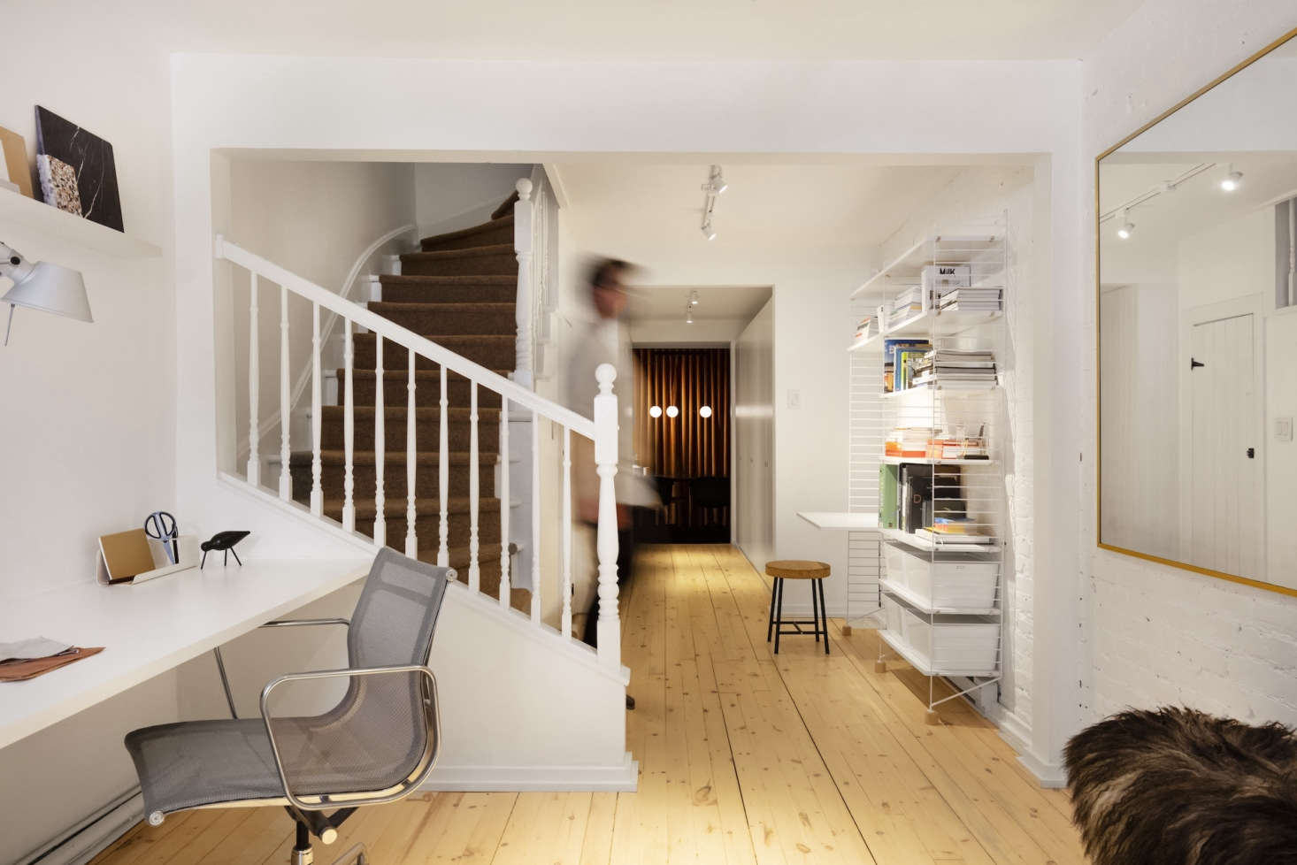The staircase is original to the 85 house. The couple added a Tretford carpet runner in lambswool. The main work area is to the left. The String shelving and desk unit on the right is additional work space for colleagues that occasionally drop in to collaborate.