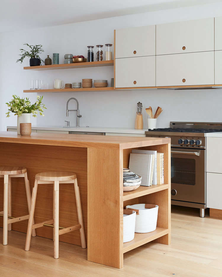 The cabinets are made up of Ikea frames with fronts from the Basis line by Reform. Displayed on the open shelves are some of Amy&#8