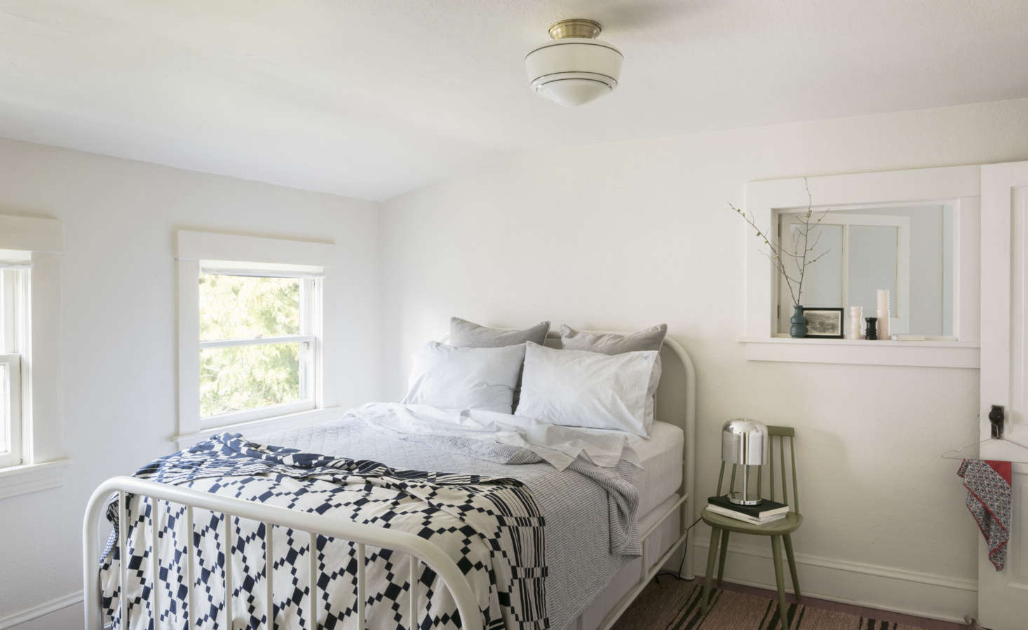 "A bedroom—never again a master bedroom. Photograph from Urban Cottage: Designer and ""Creativepreneur"" Angela Medlin's Chic Victorian in Portland, OR."