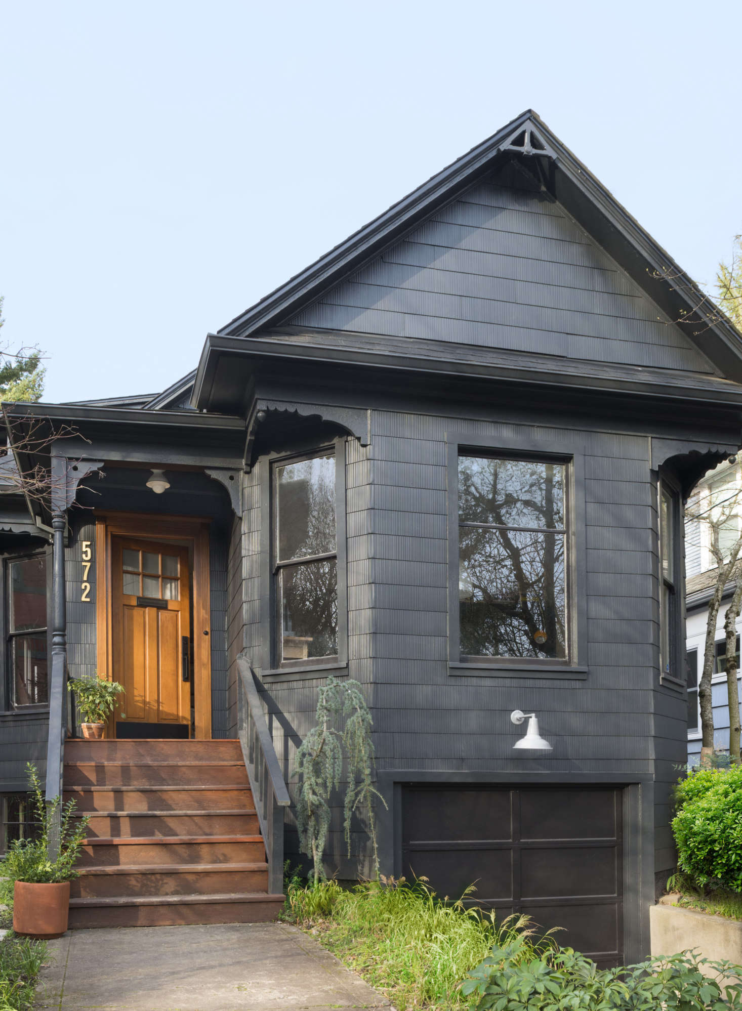 The exterior is painted in Graphite with Onyx trim, both from Benjamin Moore  (to see the transformative powers of paint, scroll to the end for a Before shot).