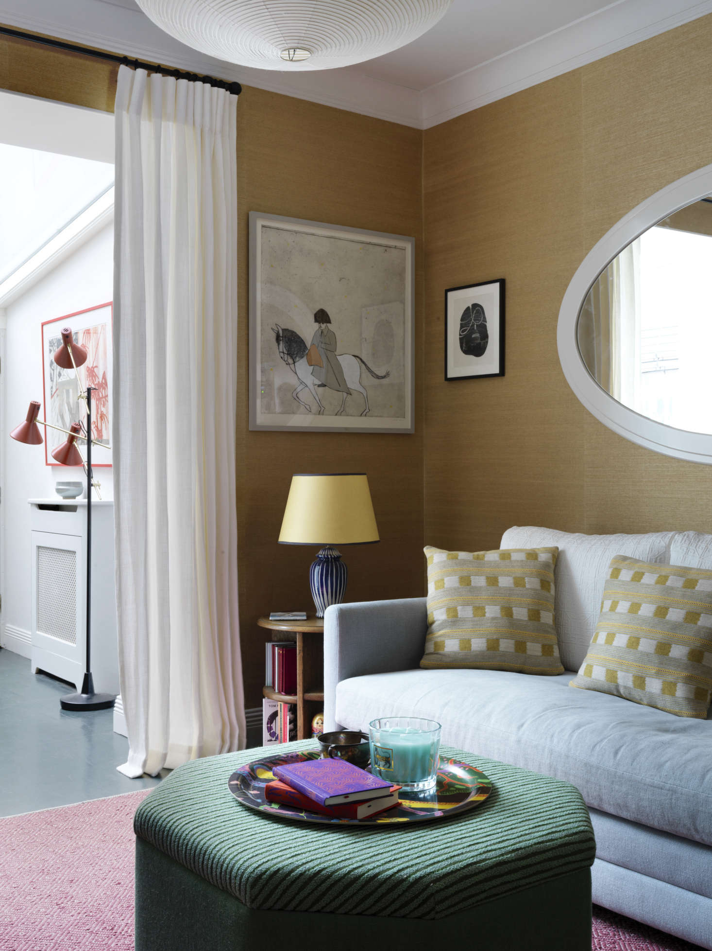 Lacking space for a door, Heuman hung a curtain of unlined white linen that &#8