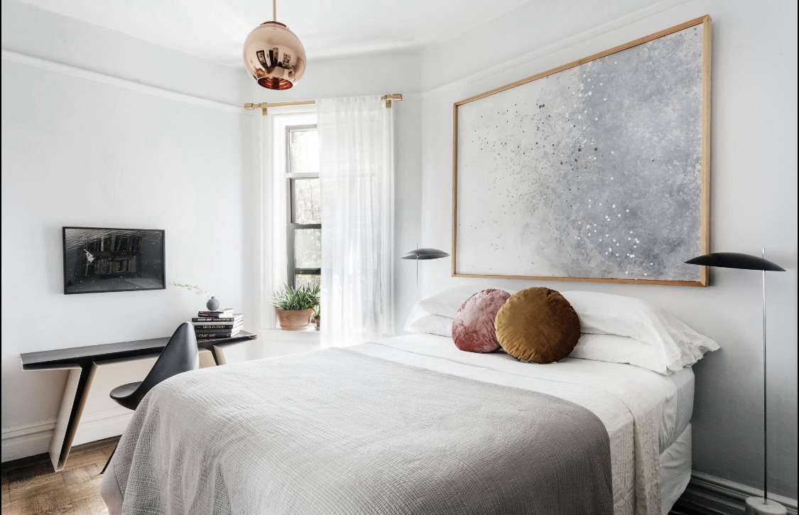 The Clam Floor Lamps flanking the bed are by Avionstudio. &#8