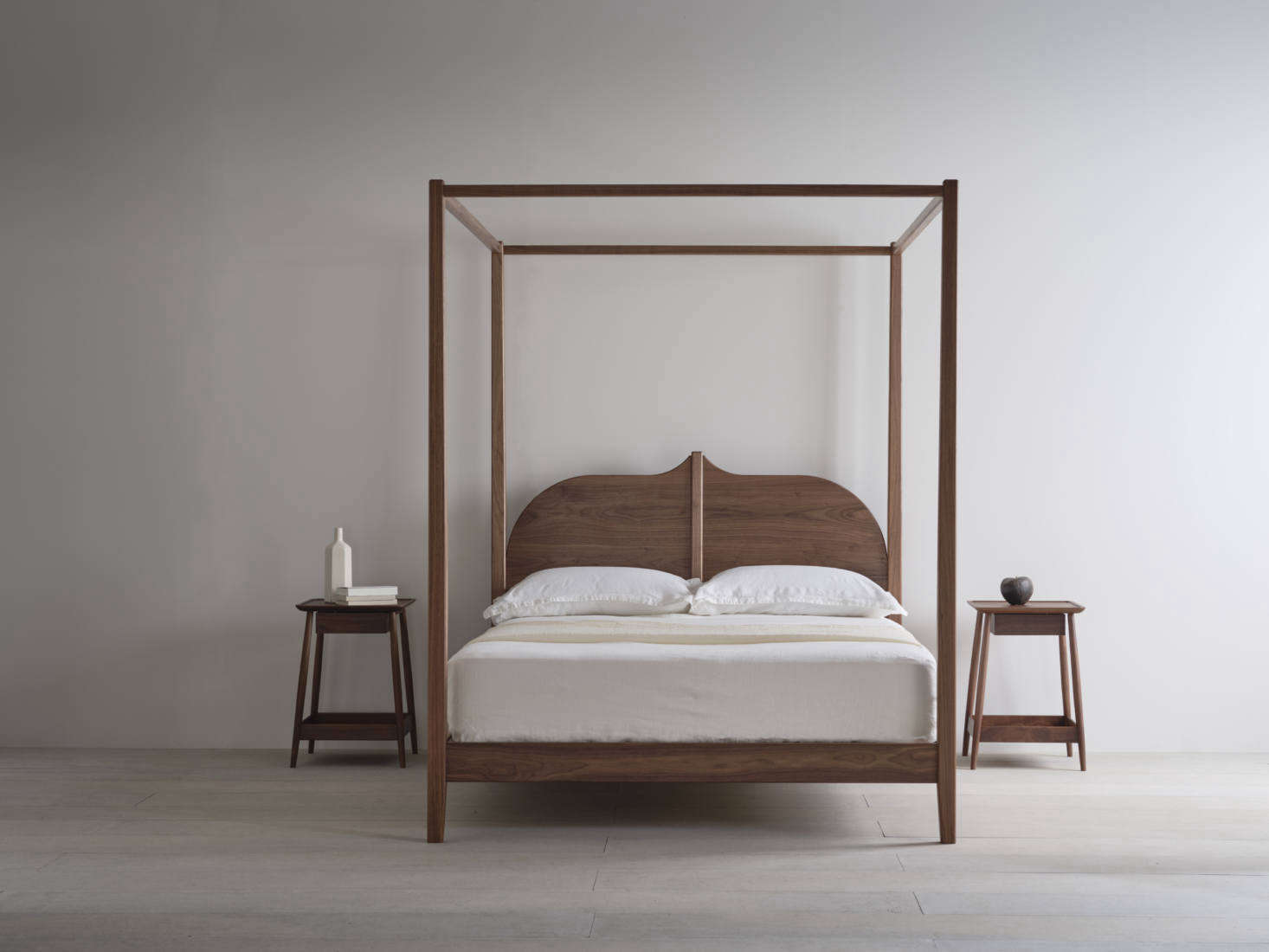 The Christo Four Poster in walnut. The bed frames are made to order and Pinch ships worldwide; see pricing on the website.