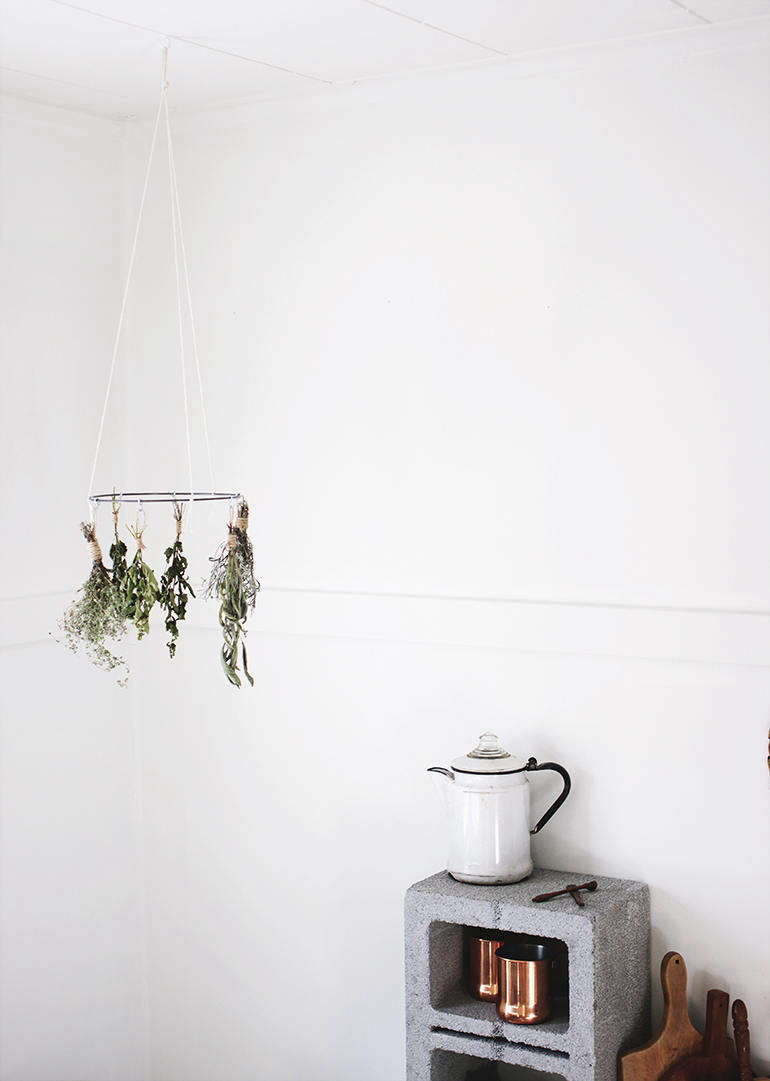 Make your own dried herbs using this DIY Herb Drying Rack. Caitlin put this one together using a hoop from a crafts store, but you can make own from a wire clothes hanger. Some herbs she says are good for air drying: sage, rosemary, thyme, bay, dill, lavender, and lemon balm.
