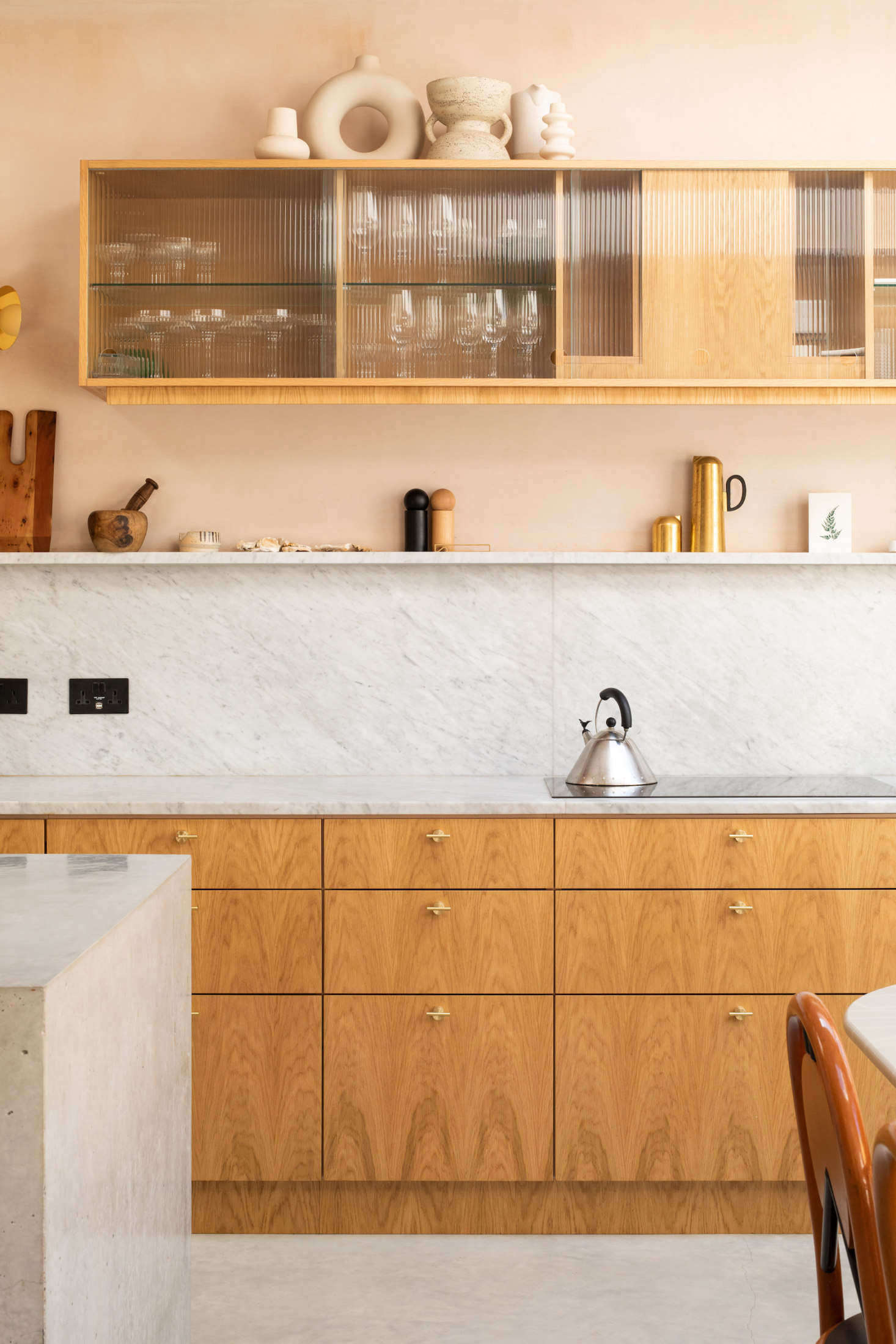 The cabinets were custom-made by the joinery experts at Oblique Furniture in London. The marble used for the countertop and backsplash was sourced from J&R Marble.