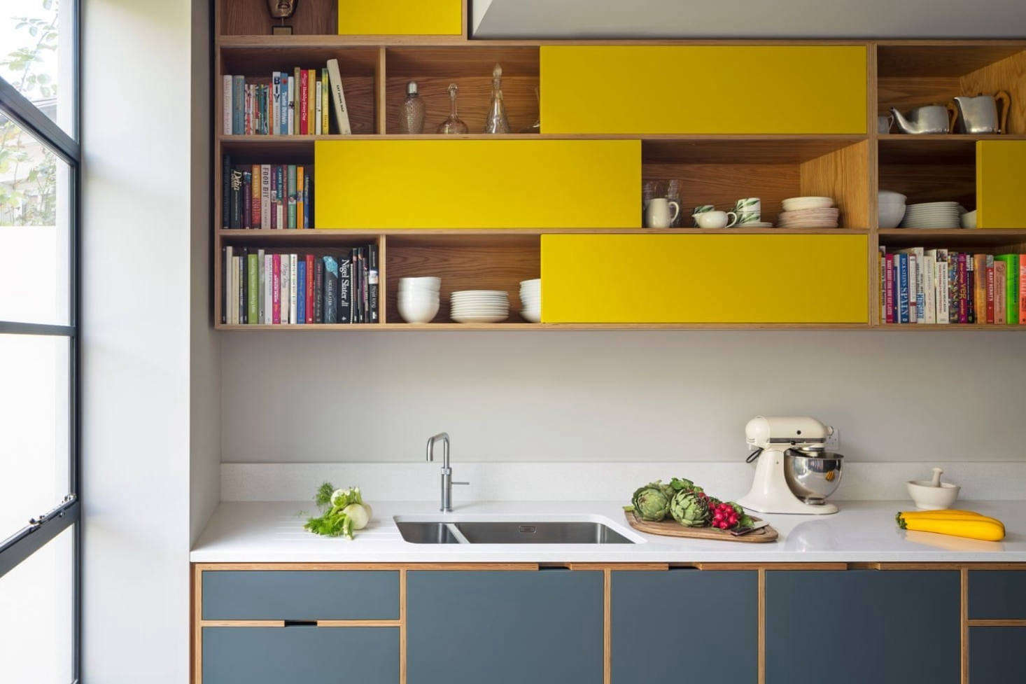 Custom cabinets by Uncommon Projects extend beyond the kitchen in this Victorian terrace house remodel in London designed by MW Architects. Explore the design in Kitchen of the Week: A Boundary-Breaking Remodel in Hampstead Heath. Photograph by Jocelyn Low from Uncommon Projects.