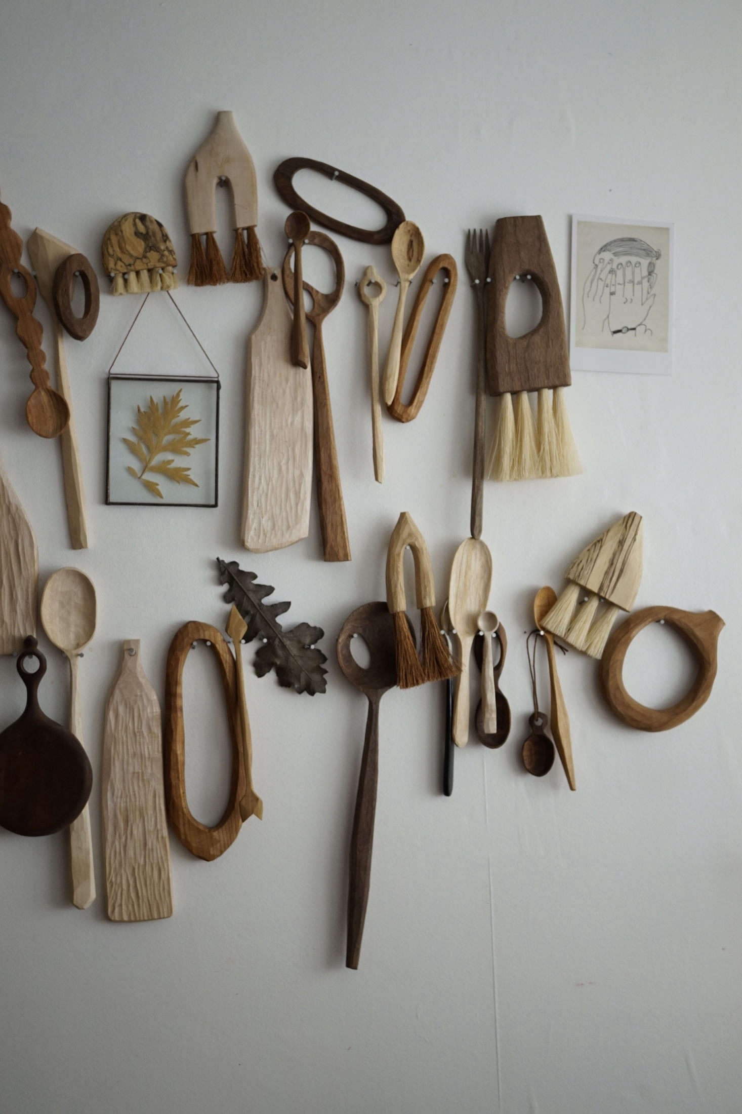 Try this at home: in a bedroom converted into her office, Sophie artfully displays her designs on a wall. (For more ideas, see  Ways to Display Wooden Spoons, Artisan Edition.)