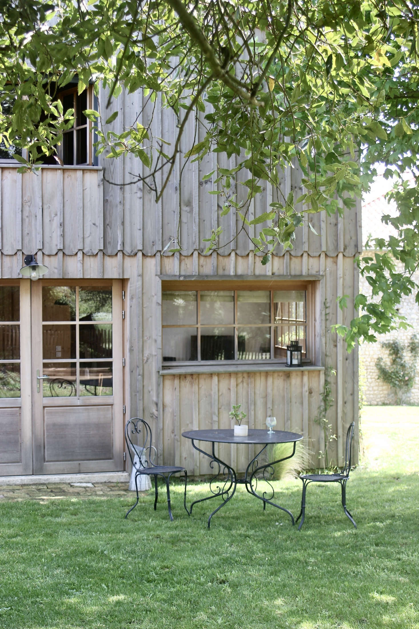 Justine and Jean redesigned what had been a bake house dating from the early th century into a board-and-batten cottage inspired by the fisherman&#8