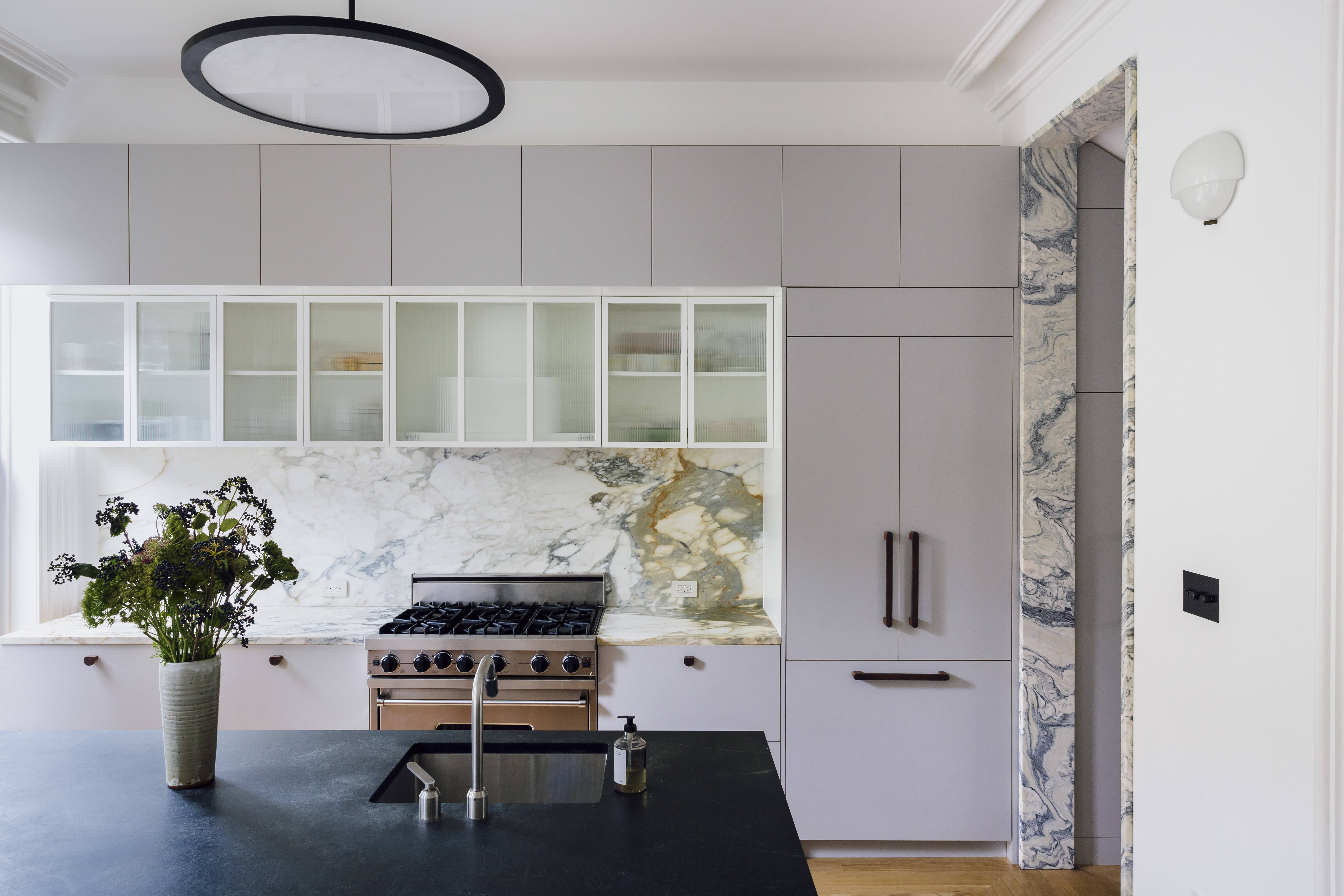 The bright, open kitchen. Note the green-toned marble on the doorjamb, an architectural detail to showcase the new entryway between kitchen and hall. &#8