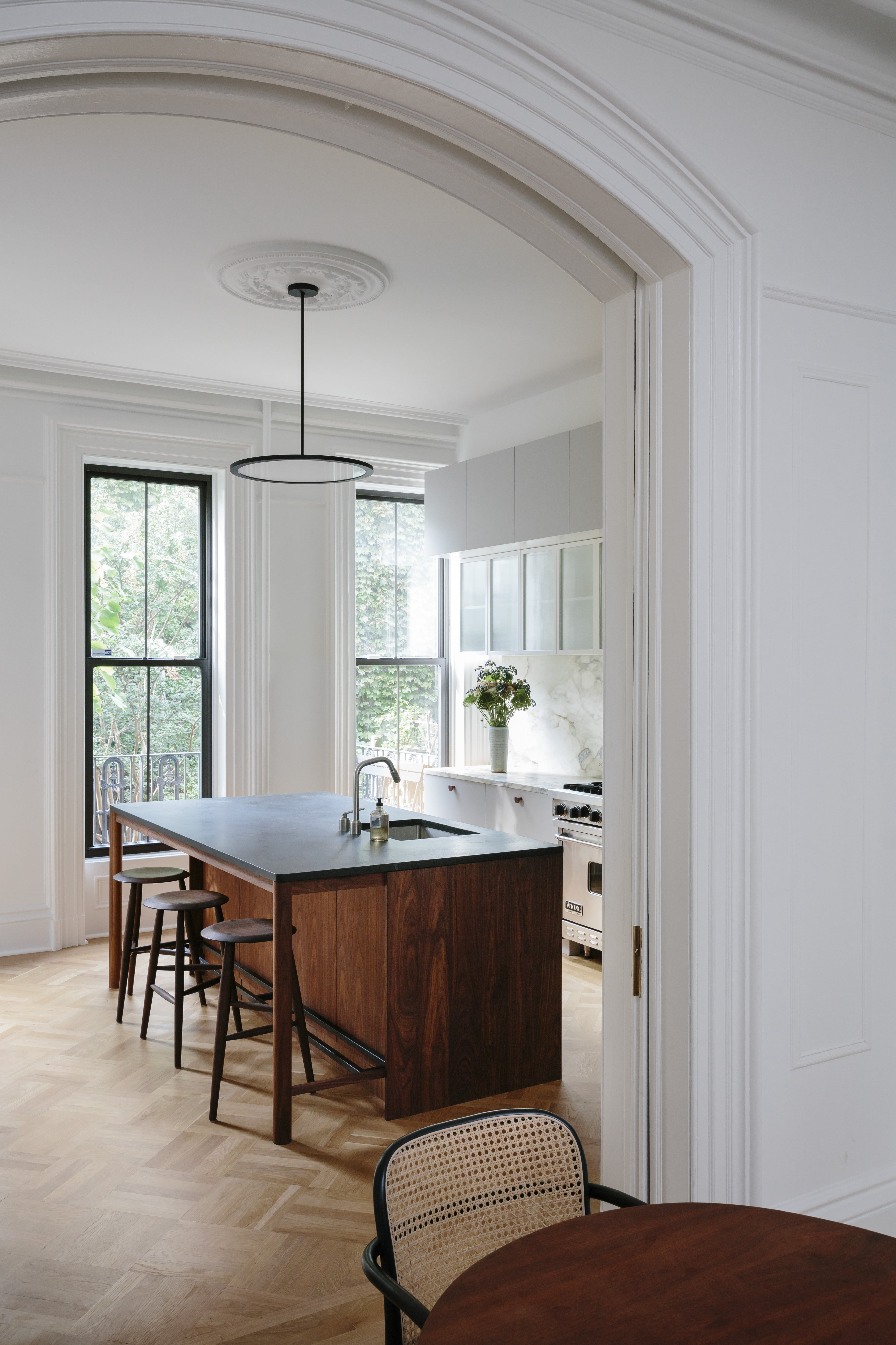 Into the kitchen. The caned dining chairs are the Hoffmann Dining Chairs by Design Within Reach.
