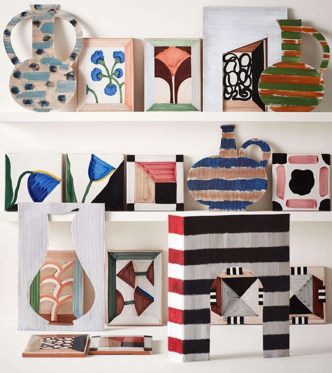 The Wayne Pate Tile Collection I is hand-painted on terracotta. There are nine designs: five rectangular vignettes and four abstract square designs.