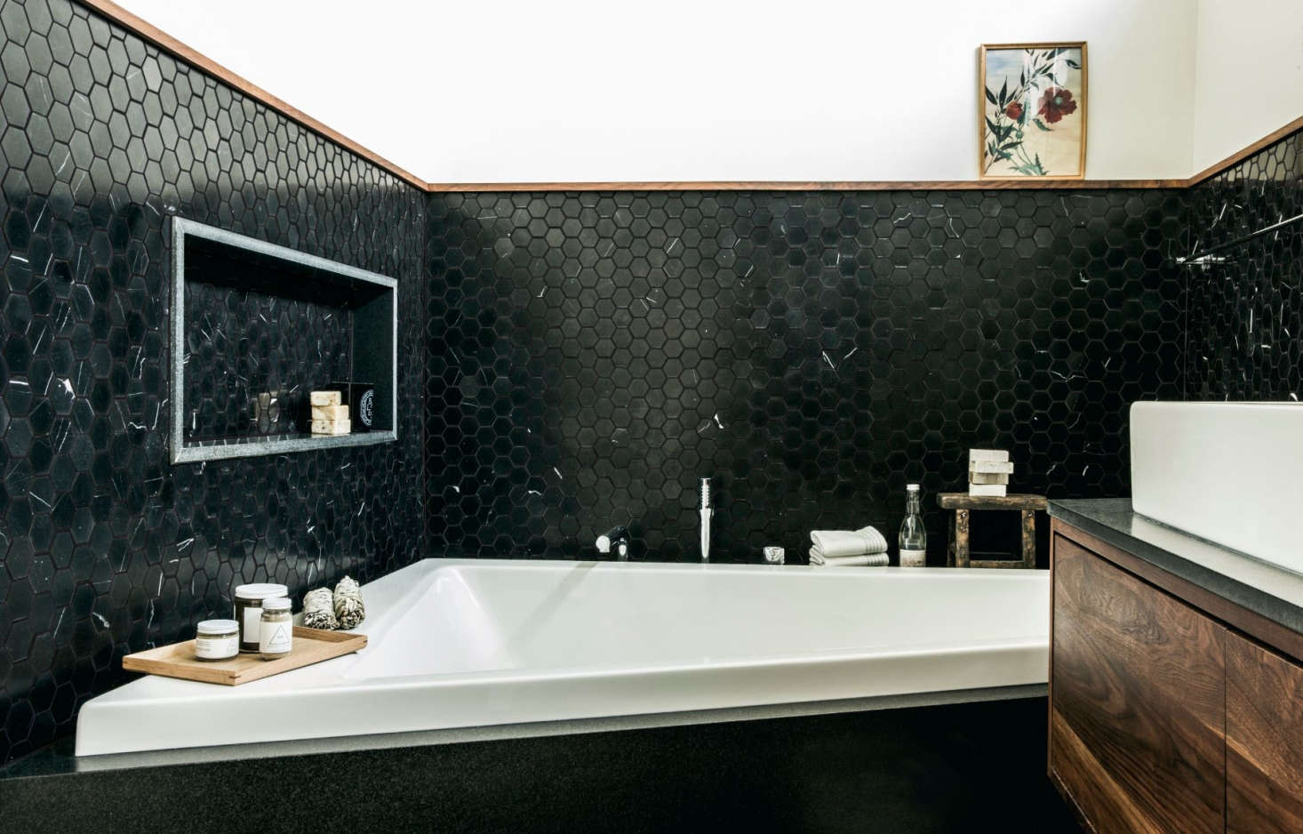 In this San Francisco project—another submission to the Remodelista Considered Design Awards— designersLynn K. Leonidasand Andrea Faucettused black granite slab for the bathtub niche and Nero Marquina marble hex tile from Ann Sacks for the surround. Photograph byAubrie Prick, courtesy of Lynn K. Leonidas.