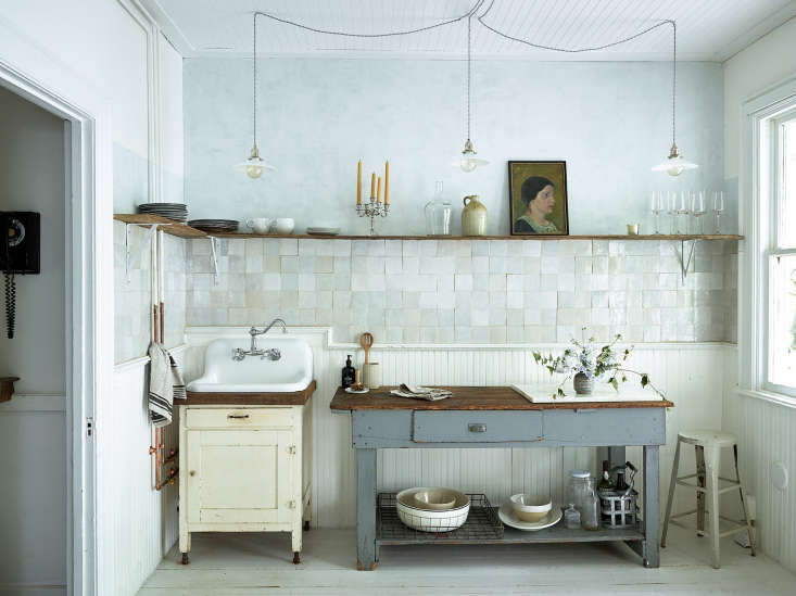 Vintage inspired rustic boho kitchen with white terracotta tiles and plaster by Zio & Sons in Hudson, NY