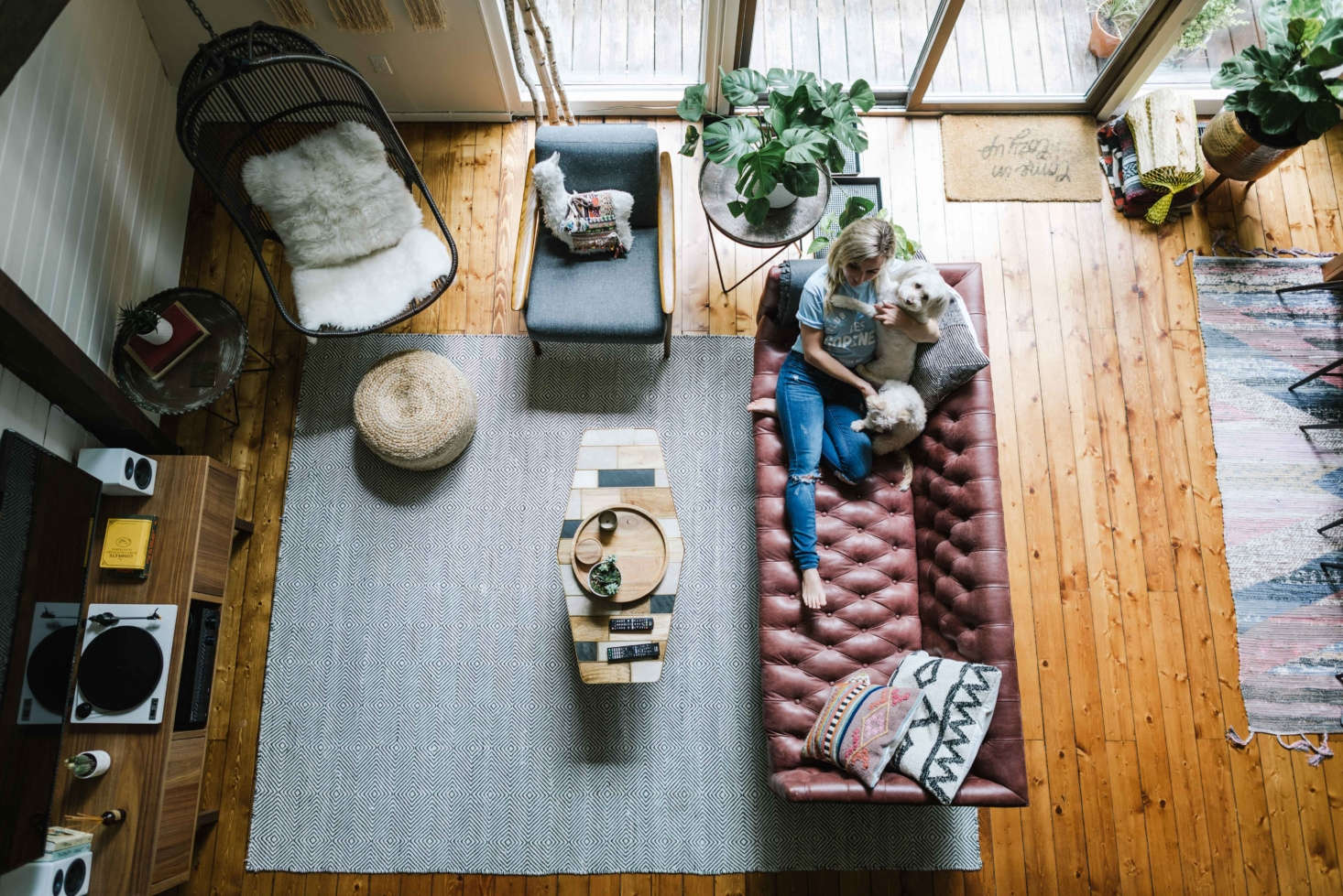 """""""Looking down at the living space from the loft you see different seating options, the TV, the record player, and the audio system—everything you need."""""""
