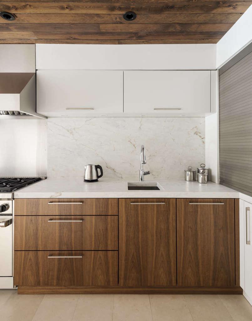 Greenwich village townhouse kitchen remodelista walnut cabinets at west wall workwithnaturefo