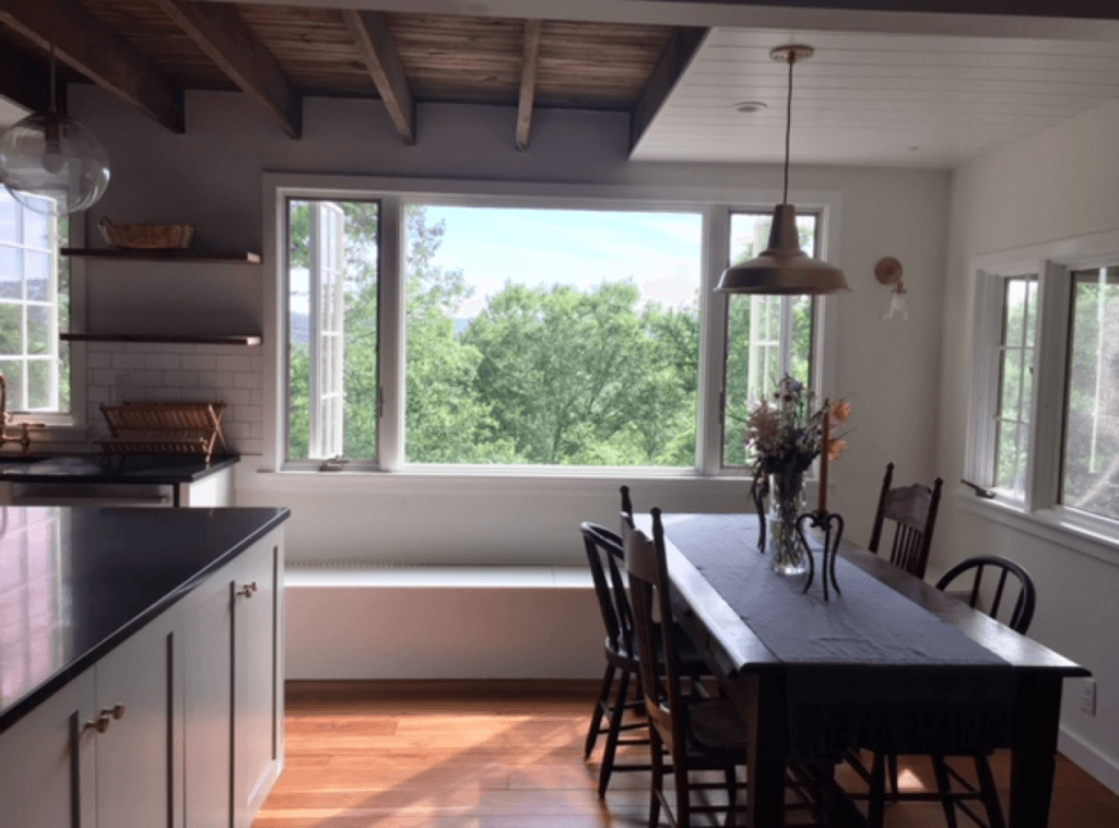 Our dining table sits within the open kitchen.
