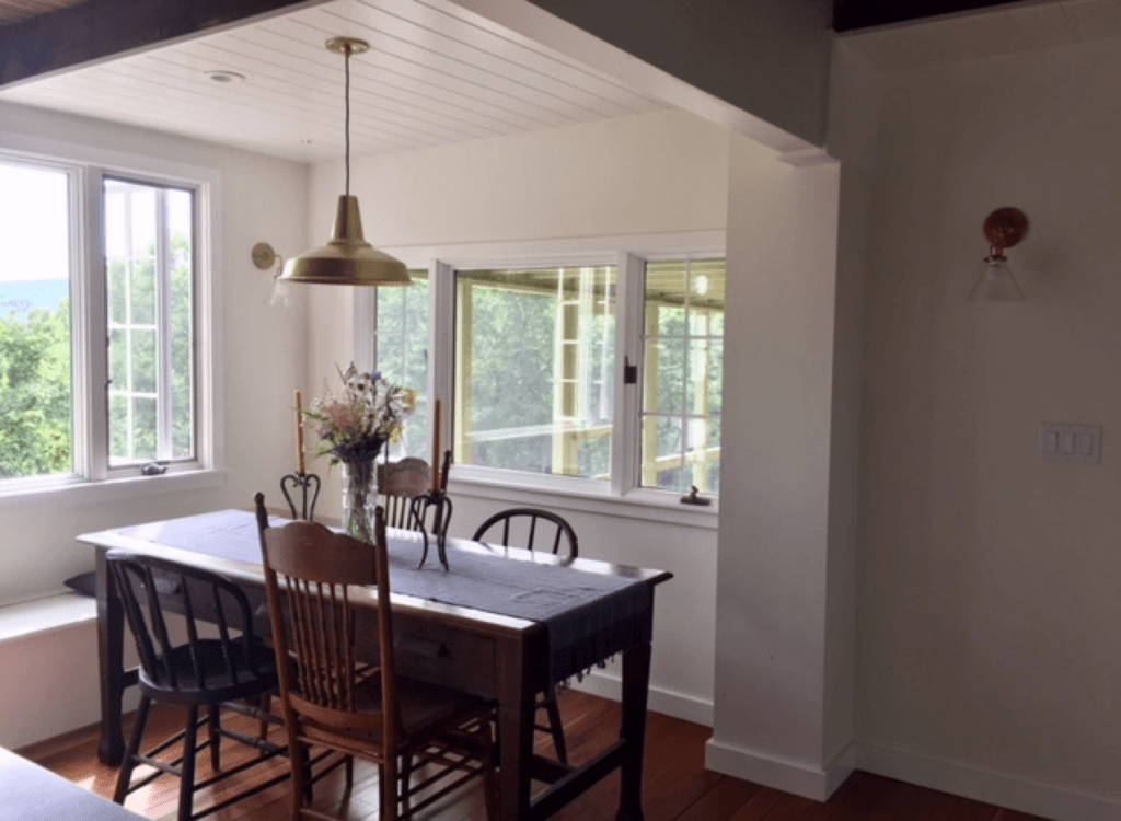 Our dining room is perched between our kitchen island and the screened in porch.